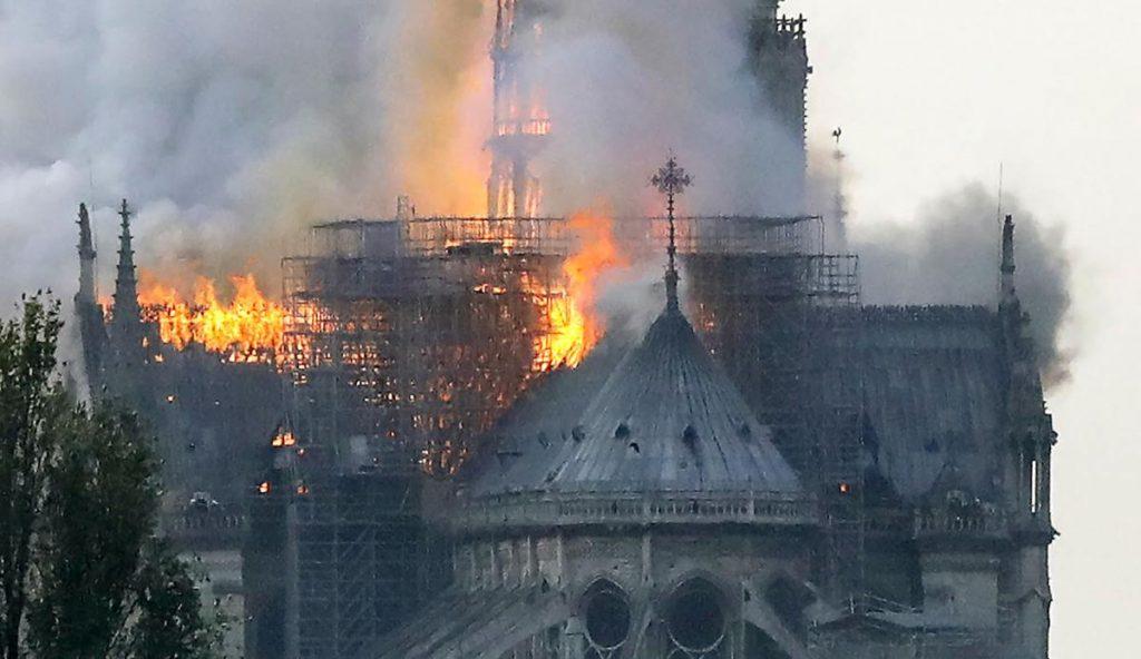 Notre Dame de Paris still stands; massive fire extinguished; experts assess structure, massive fire damage